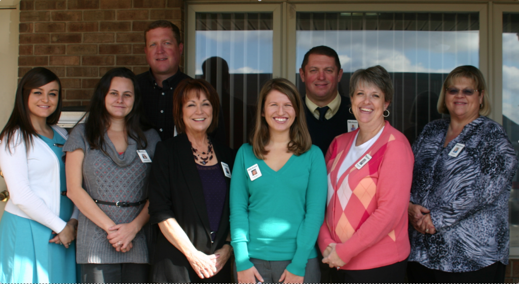 From left, Mary Beth Sallee ( classified advertising), Andrea Yates (circulation), Geoff Botkin (ad sales), Cheryl Magers (ad manager), Leslie Moore (reporter), Jeff Moreland (publisher), Becky McCorvey (composition), and Suzy Houk (bookkeeping). Photo by David Greer.