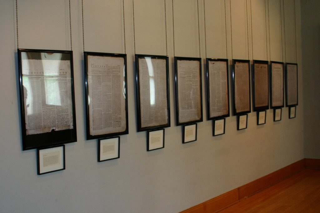 Front pages from several issues of the Kentucke Gazette hang on the wall in the Bradford Museum at Cardome Center in Georgetown