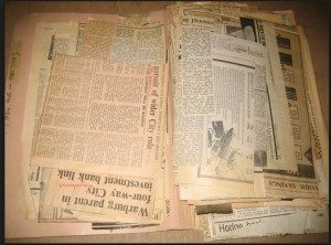 newspaper-history-pile-300x222