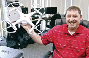 """Randy Cash, Audio/Video Crew Leader with the City of Owensboro, shows off the City's DJI Phantom remote-controlled helicopter in his office at City Hall on Monday. With the device, Cash can attach a GoPro camera and shoot aerial video of downtown construction, planning projects and outdoor events. """"We've had it at the new convention center and hotel and it works great for construction,"""" Cash said."""