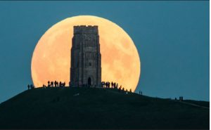The supermoon rises behind Glastonbury Tor on September 27, 2015 in Glastonbury, England. (Matt Cardy | Getty Images)