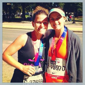 Stevie, left, and friend Sarah at the finish line of the Chicago Marathon
